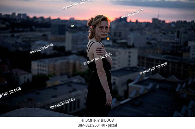 Portrait of serious Caucasian teenage girl overlooking cityscape