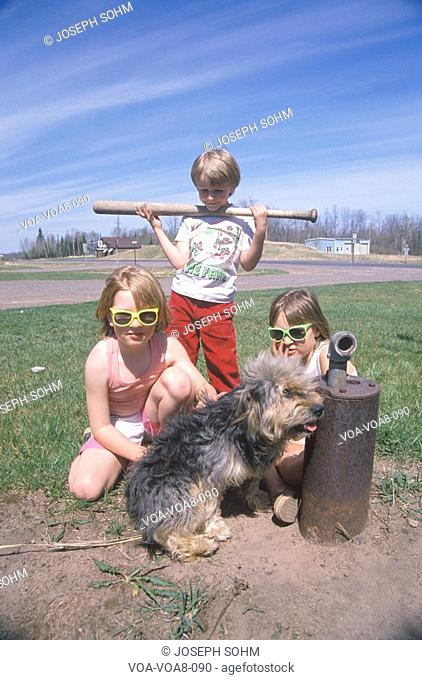 Three children with their dog playing in Dairyland, WI