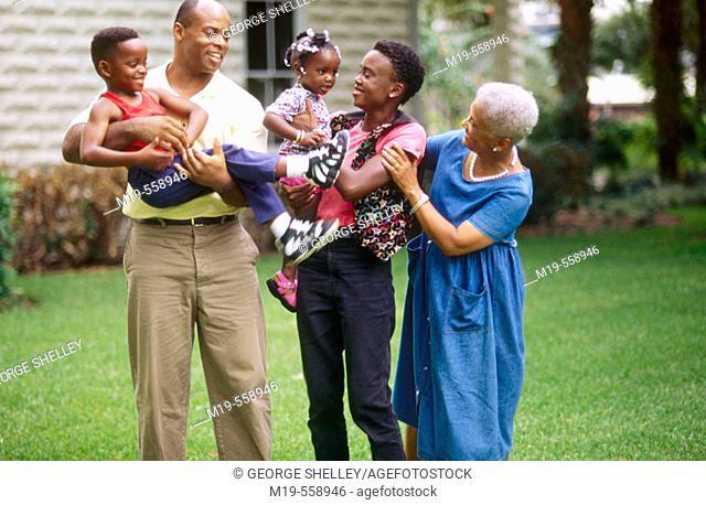 three generation standing outdoors
