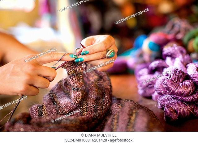 Close-up view of woman knitting