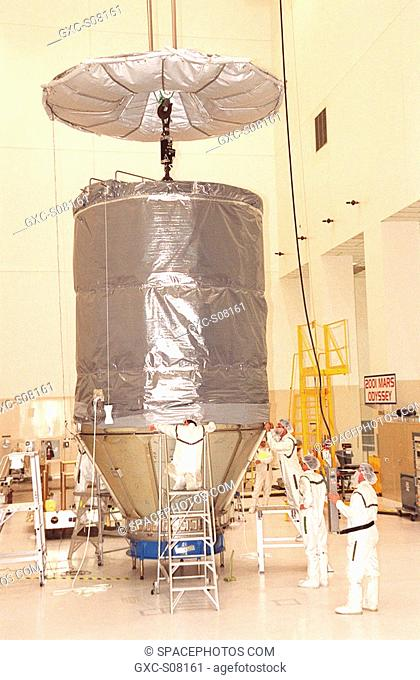 03/26/2001 --- In the Spacecraft Assembly and Encapsulation Facility 2, workers attach the upper canister to lower panels that surround the Mars Odyssey orbiter