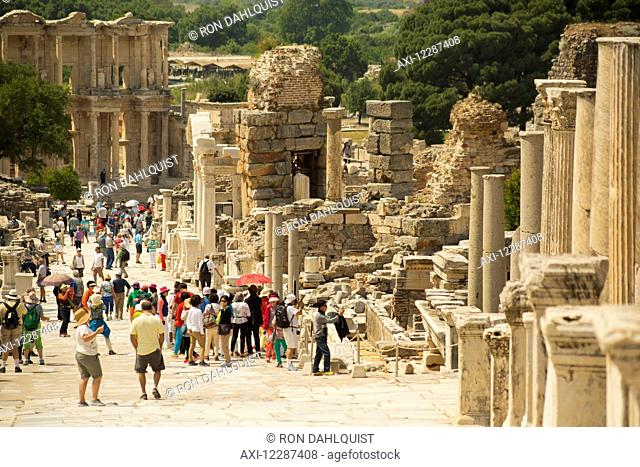 Tourists walking on Curetes Street to the Library of Celsus; Ephesus, Turkey