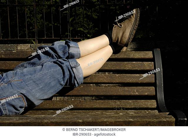 Woman's legs on a bench