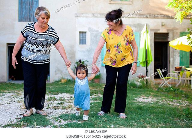 12-month old baby with her adoptive grandmothers