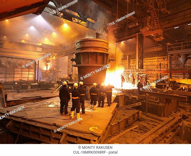 Steel Workers With Ladel And Sparks