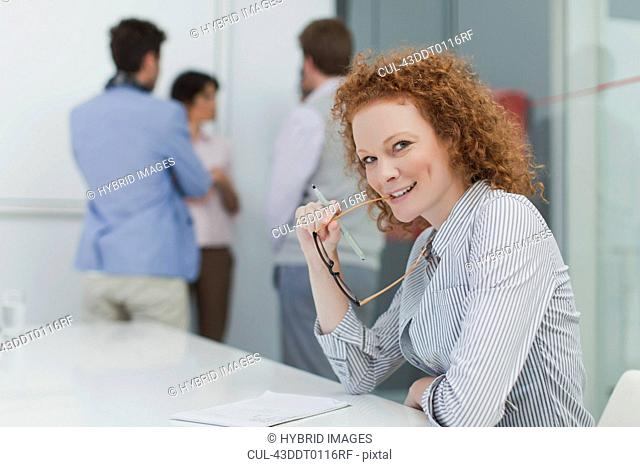 Businesswoman sitting in meeting