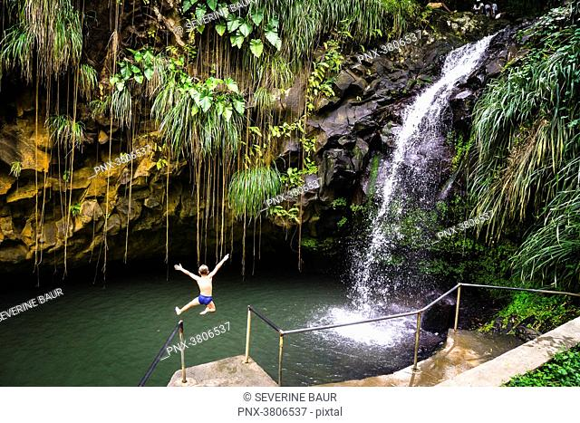 A kid jumping at the Annandale's Falls, Grenada, West Indies