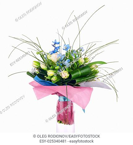 Flower bouquet from tulips, iris and other flowers arrangement centerpiece isolated on white background