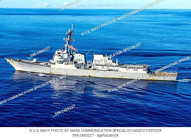 WATERS NEAR GUAM (July 26, 2015) Sailors assigned to the Arleigh Burke-class guided-missile destroyer USS Mustin (DDG 89) man the rails to commemorate the 12th...