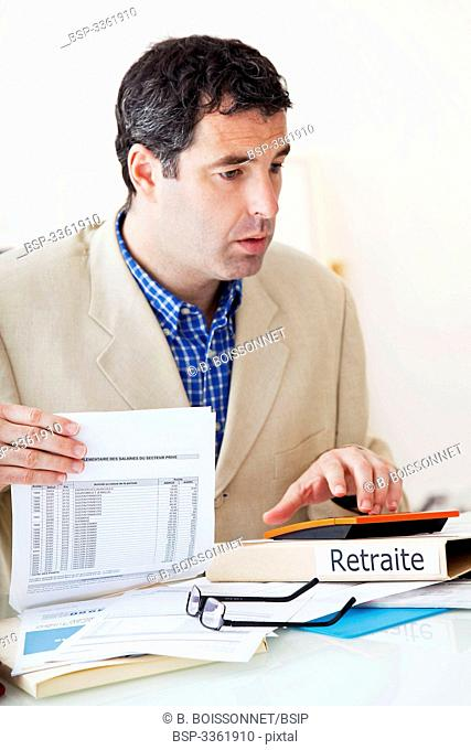 MAN FILLING OUT FORMS Model