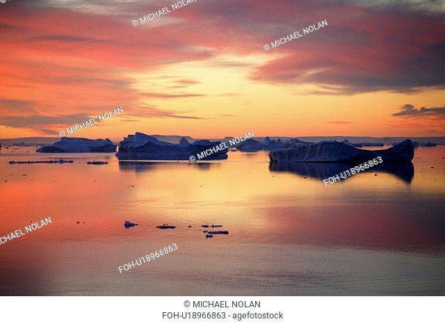 Sunset on fresh sea ice and tabular icebergs in the Weddell Sea, Antarctica