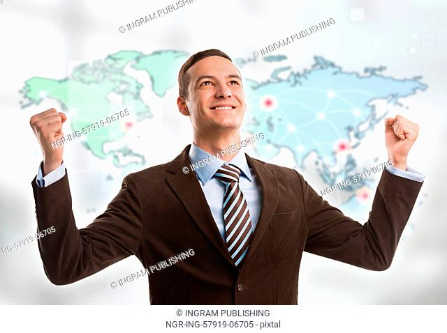 Portrait of young man standing in front of big world map. Server locations and actual online connections are displayed on virtual map