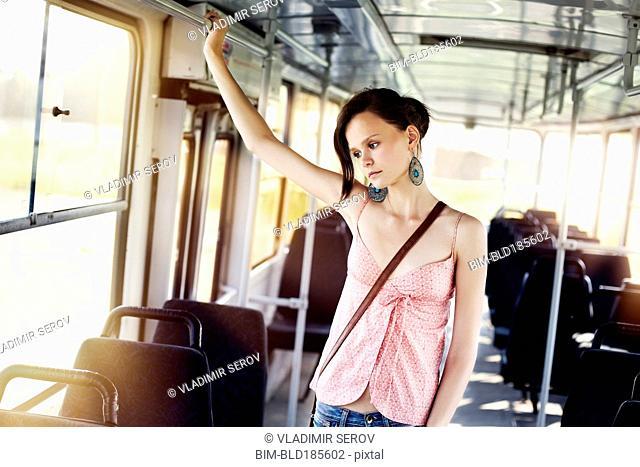 Caucasian woman riding bus