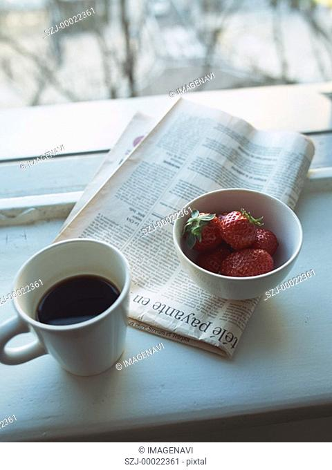 Coffee and strawberry by window