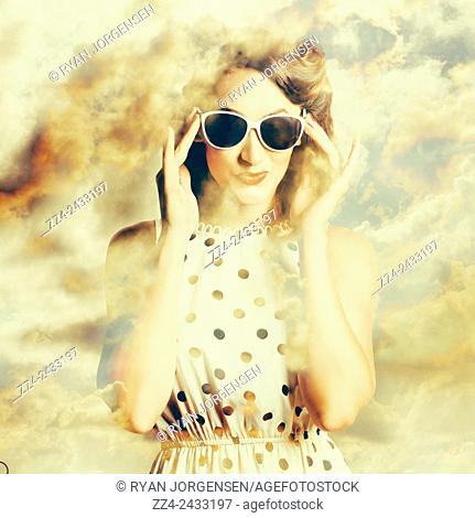 Vintage surrealism photo of an old style woman with head in the clouds. Pinup fashion dreams