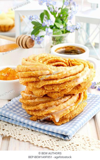 Churro donuts and bowl of honey. Spain dessert