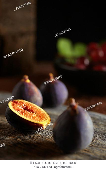 Fresh ripen figs on a wooden table