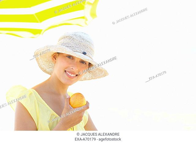woman at beach with sun hat