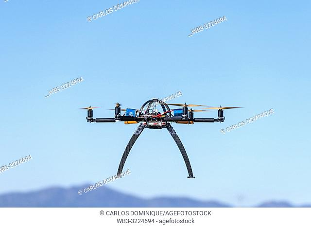 Professional drone hovering in a test flight session