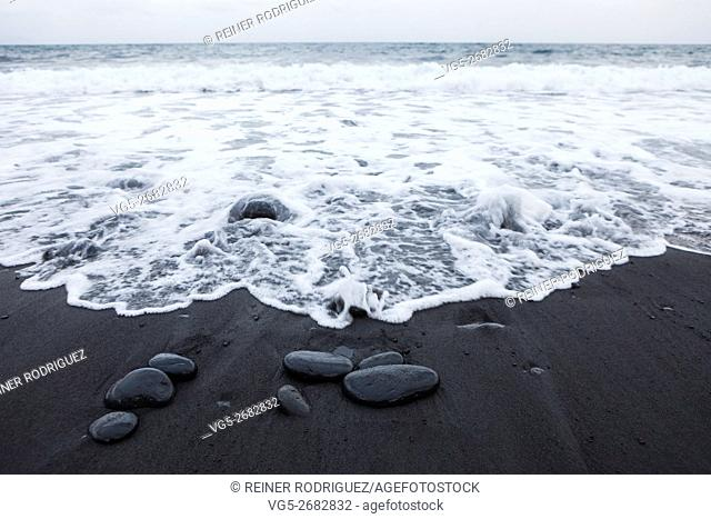 black volcanic stones and sand at the eastern coast of Tenerife, Canary Islands, Spain