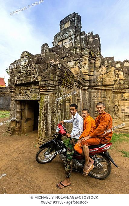 Young Buddhidt monks on a moto at the temple of Wat, Phnom, Nokor, on the Mekong River, Kampong Cham Province, Cambodia, Khmer