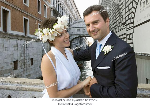 Bride and Groom in front of the bridge of Sighs Venice Italy