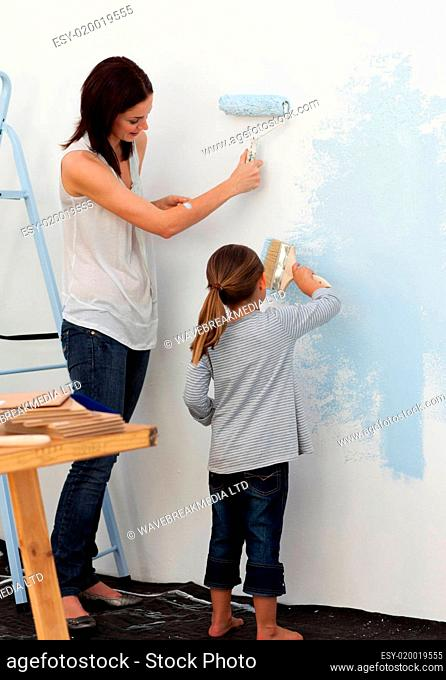 Mother and her daughter painting together