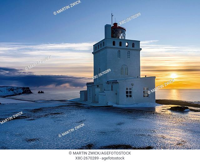 The lighthouse at cape Dyrholaey. Coast of the North Atlantic near Vik y Myrdal during winter. europe, northern europe, scandinavia, iceland, February