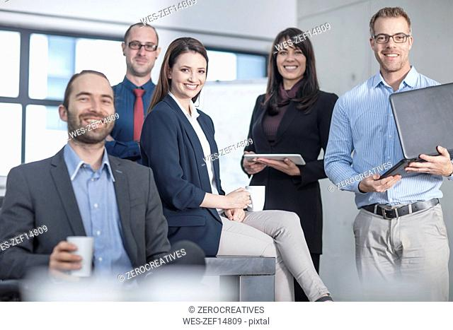 Portrait of smiling business team in office