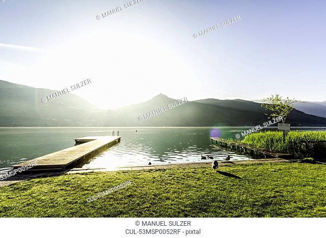 Wooden pier in still rural lake