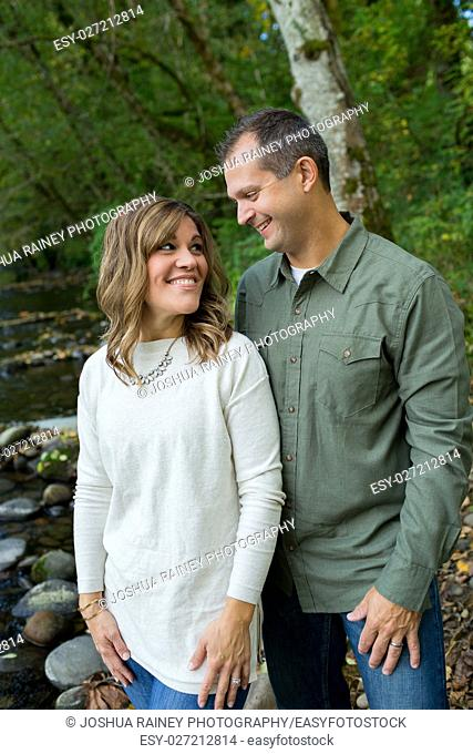 Portrait of a happy couple along the banks of the McKenzie River in Oregon