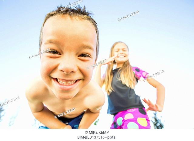 Low angle view of Caucasian children smiling outdoors