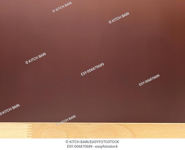 A close up shot of a wooden shelf