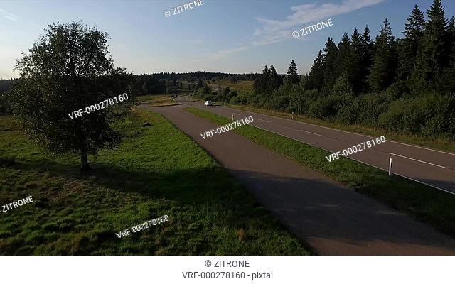 Drone shot of road and green landscape, Kniebis, Baden-Wuerttemberg, Germany
