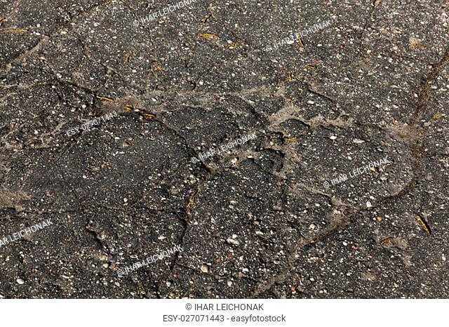 photographed close-up part of the road on which the broken cover - asphalt