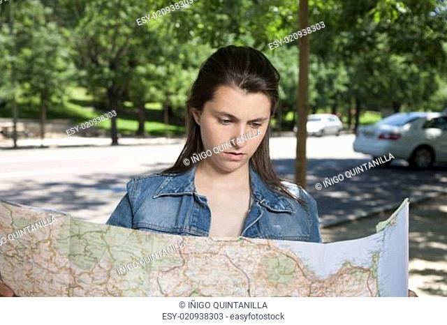 young woman watching map