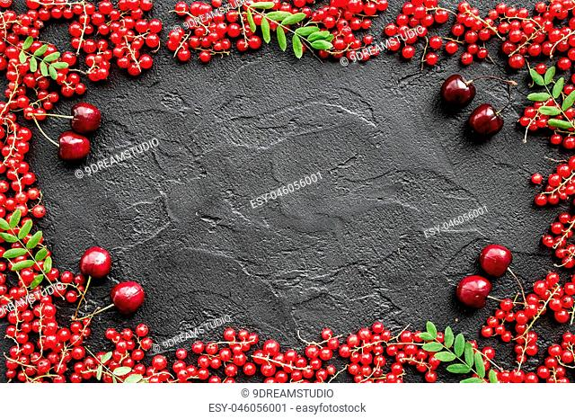 Berry frame on balck table background top view