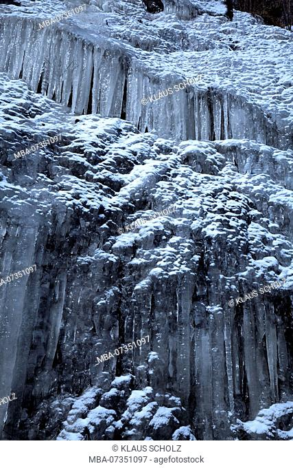 Icicles covering steep rock face