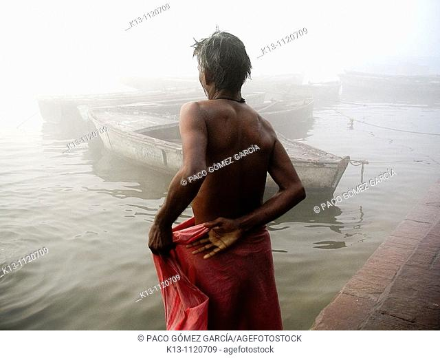 Pilgrims bathing at ghat steps on river Ganges  Varanasi banaras  Uttar Pradesh  India