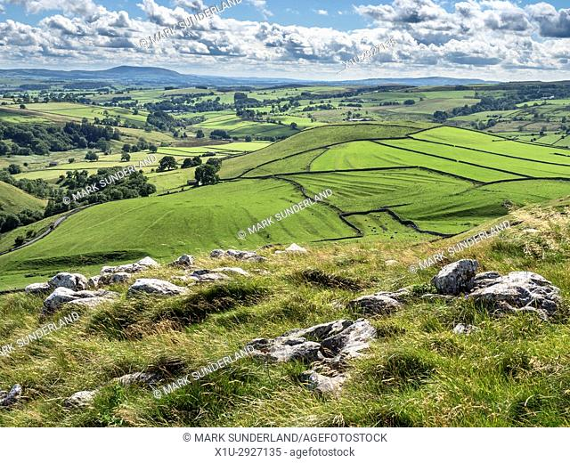 View from above Gordale Scar across Malhamdale toward Pendle Hill Malham Yorkshire Dales England
