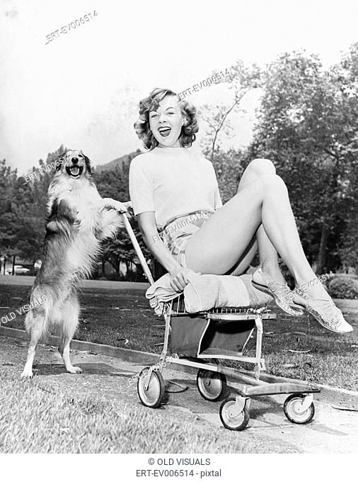 Young woman and her pushy pet dog All persons depicted are not longer living and no estate exists Supplier warranties that there will be no model release issues