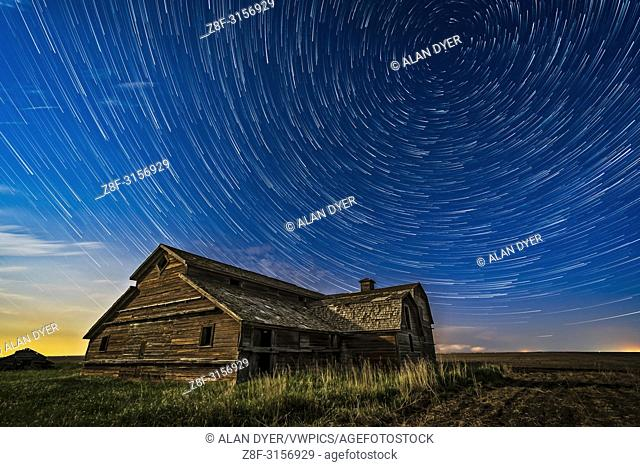 Circumpolar star trails over a grand old barn in southern Alberta, on a fine spring night, May 23, 2018. Illumination is from the waxing gibbous Moon to the...