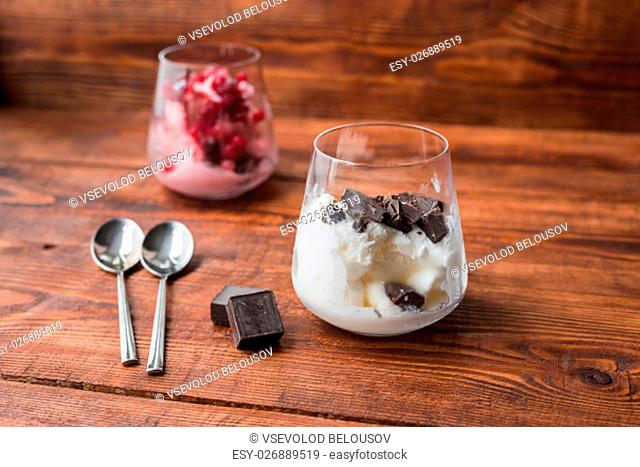 Dessert for two. Vanilla ice cream with chocolate and strawberry ice cream with red currant
