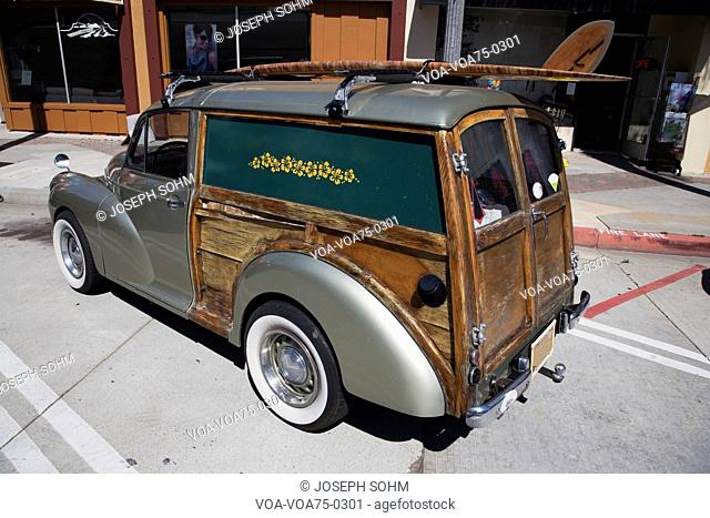 Mini woody station wagon with surf board, Ventura, California, USA