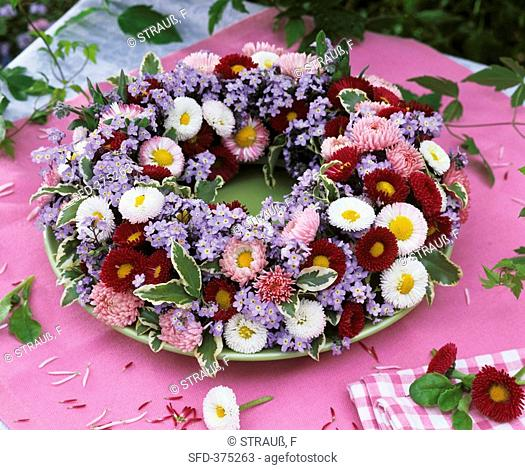 Wreath of bellis, forget-me-nots and pittosporum