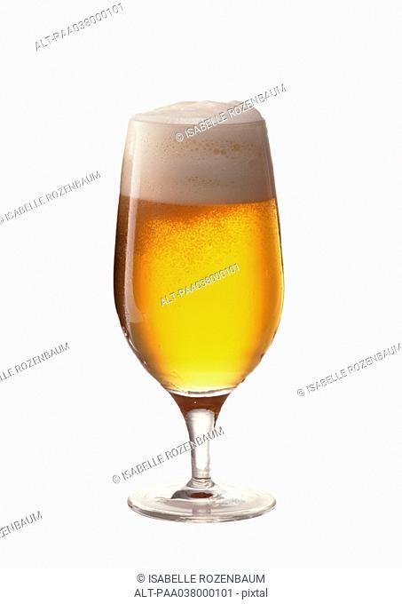 Beer in stemmed glass, full length, white background