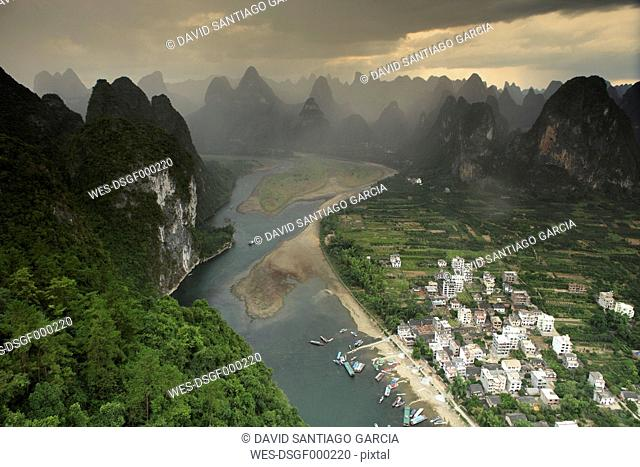 China, Guangxi, rainstorm above Xingping at Li river