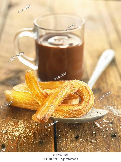 Churros with melted chocolate