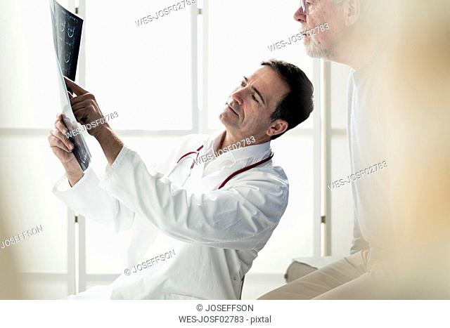 Doctor discussing MRT image with patient in medical practice