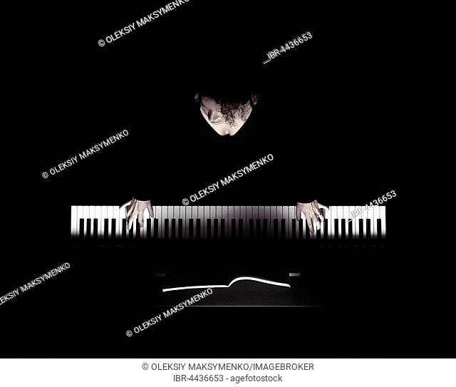 Woman playing the piano, white keys and hands on black background, overhead view in dramatic light